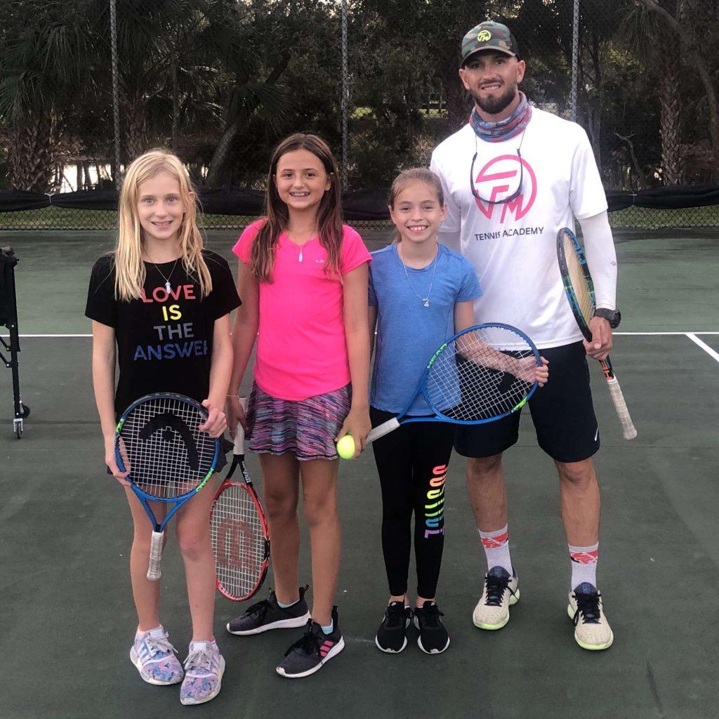 Brandon Flanagan with junior tennis lessons