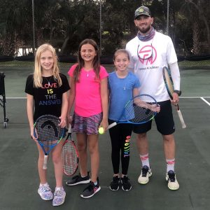 Brandon Flanagan with junior tennis players