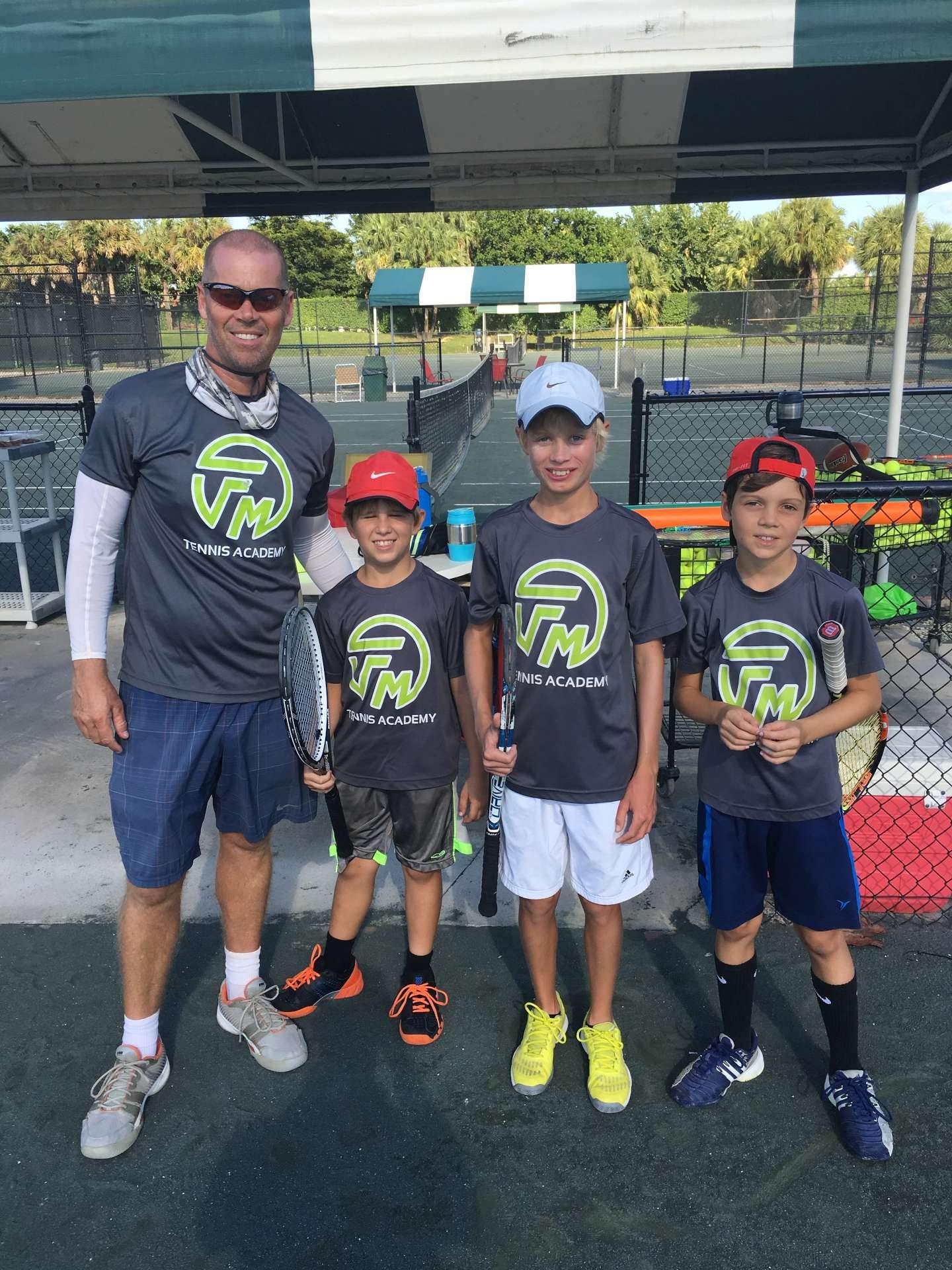Allington Mutimer with three junior tennis player